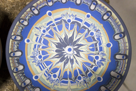 crockery painted with engobe is a slip mixed with multi-colored pigments on a pottery apartment with the participation of a Bulgarian craftsman with 14 years of experience. the national name is Trojan Shanka