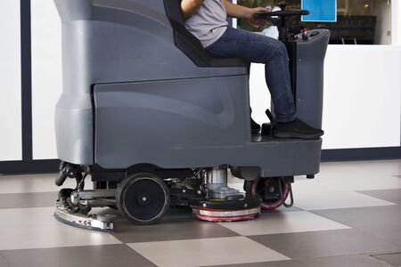 Photo pour Brush in the battery scrubber-dryer in Russian airport. - image libre de droit
