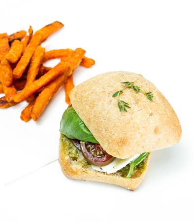 fresh mozzarella and tomato sandwich with fresh basil served with sweet potato fries