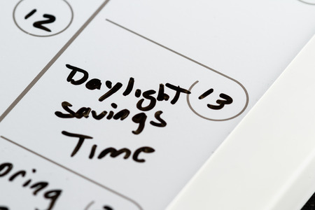 March 13th on a calendar marked with daylight savings time with aback marker