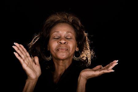 african american woman praising God