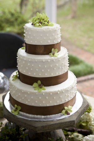 wedding cake and boquets on table