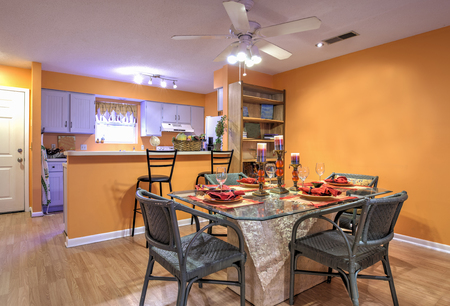Photo pour Open concept apartment with diningroom and kitchen and orange walls - image libre de droit