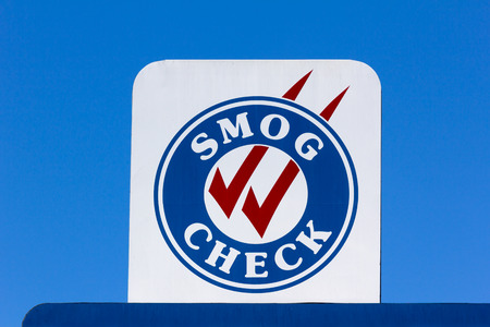 Smog Check sign at automotive repair shop in the United States