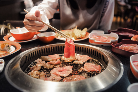 Photo for Raw beef and pork slice on grille for barbecue or Japanese style yakiniku - Royalty Free Image