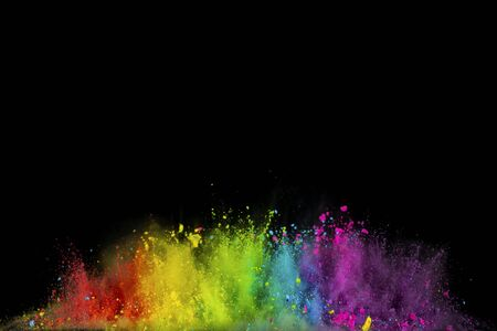 Photo pour Explosion of colored powder isolated on black background. Abstract colored background - image libre de droit