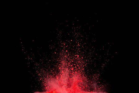 Foto de Red powder explosion on black background. - Imagen libre de derechos