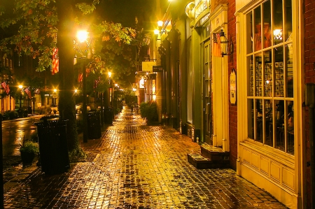Alexandria, Virginia, USA - September 30  A moody street scene on a rainy night in Old Town Alexandria, Virginia on Sept  30, 2006