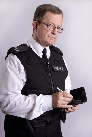 UK Police officer taking notes