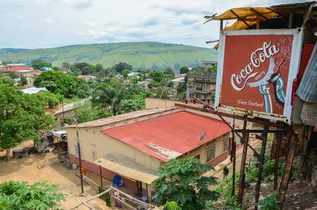 View over the Congolese river town Matadi with buildings and Coca Cola billboard, Democratic Republic of Congo, Africa