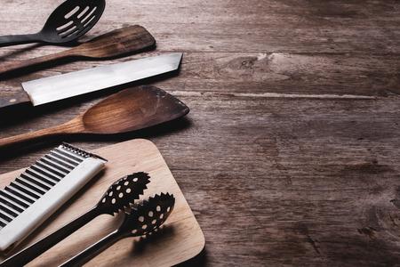 Old kitchenware on wooden background.