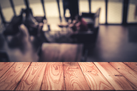Empty top wooden table with defocus or blured of bokeh background. For product display
