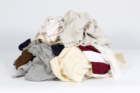 Pile of old clothes on white background