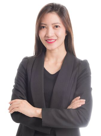 Foto de A businesswoman in a black suit with arms crossed and smiling face isolated on white background. - Imagen libre de derechos