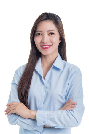 Photo pour Asian woman in blue shirt arms crossed with a smiling face isolated on white - image libre de droit