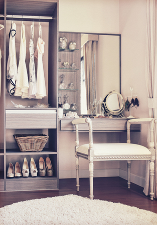 vintage style photo of dressing room with classic white chair and dressing table
