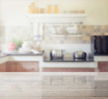 Photo pour granite table top and blur of modern kitchen interior as background - image libre de droit