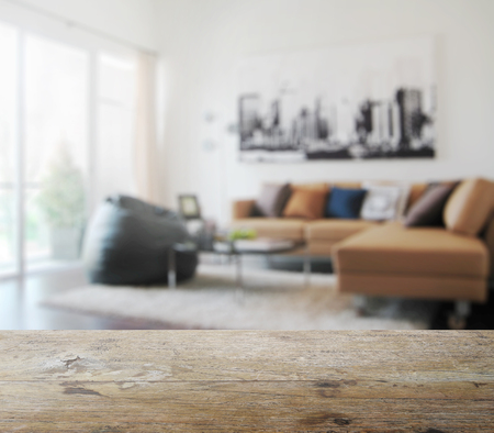 Photo pour wooden table top with blur of modern living room interior as background - image libre de droit