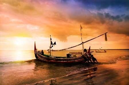 Photo pour local boat on the beach at sunset time . Bali , Indonesia - image libre de droit