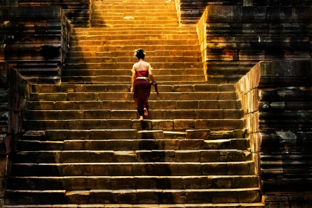 girl climbing up stairs of castle stone