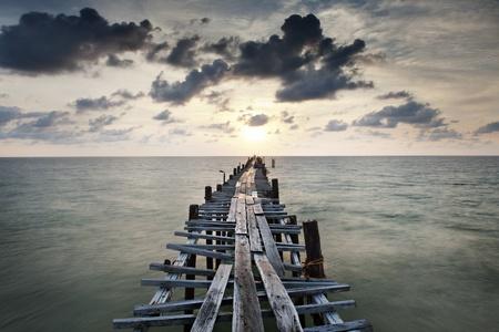 Old wood bridge to sea