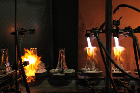 SVETLA NAD SAZAVOU, CZECH REPUBLIC - NOVEMBER 7, 2014: Automatic production of decorative glass vases at the Bohemian glass factory Crystalite Bohemia in Svetla nad Sazavou, Czech Republic.