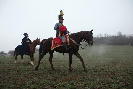 TVAROZNA, CZECH REPUBLIC ? DECEMBER 3, 2011: Re-enactors uniformed as Austrian cavalry attend the re-enactment of the Battle of Austerlitz (1805) near Tvarozna, Czech Republic.