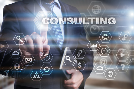Photo pour Businessman is pressing on the virtual screen and selecting Consulting. - image libre de droit