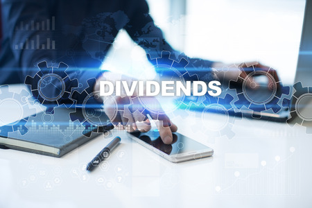 Businessman is working in office, pressing button on virtual screen and selecting dividends.