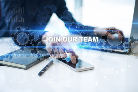 Businessman is working in office, pressing button on virtual screen and selecting join our team.