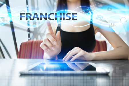 Woman is using tablet pc, pressing on virtual screen and selecting franchise