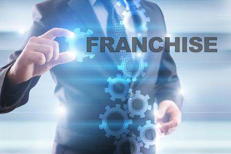 Businessman selecting franchise on virtual screen.