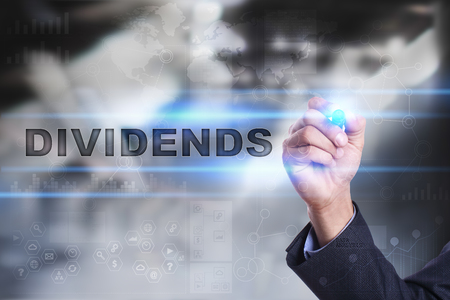 Businessman is drawing on virtual screen. dividends concept.