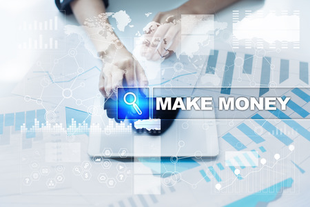Woman working with documents, tablet pc and selecting make money.