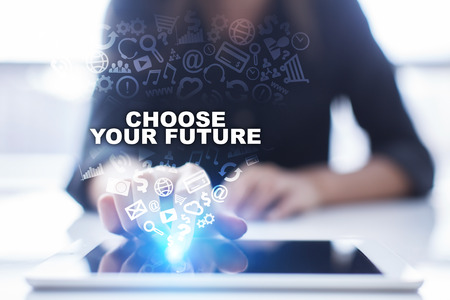 Photo pour Woman is using tablet pc, pressing on virtual screen and selecting choose your future. - image libre de droit