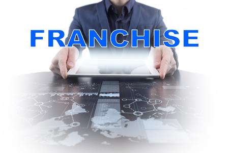 Businessman working with modern tablet PC and presenting franchise concept.