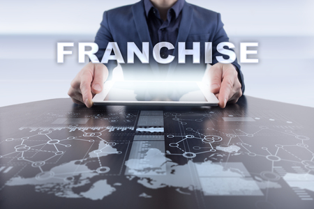 Businessman using tablet pc and selecting franchise.