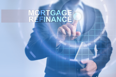 Businessman selecting mortgage refinance on virtual screen.