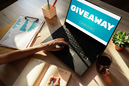 Photo pour Giveaway, enter to win text on screen. Lottery and prizes. Social media marketing and advertising concept. - image libre de droit