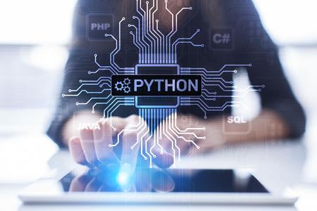 Foto de Python high-level programing language. Application and web development concept on virtual screen. - Imagen libre de derechos