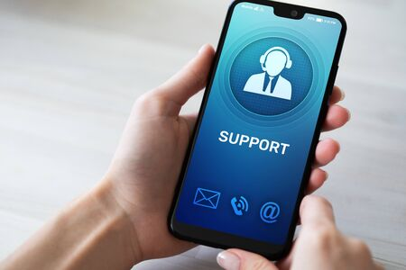 Photo pour Support, Customer service icon on mobile phone screen. Call center, 24x7 assistance. - image libre de droit