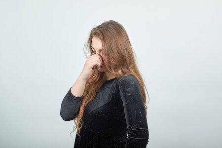 Photo pour girl brown haired in black dress over isolated white background shows emotions - image libre de droit