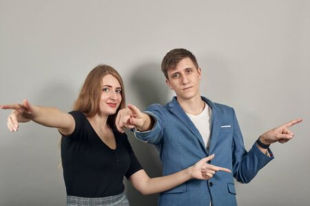 Photo for Hand pointer with forefinger pointing forward. Index finger to show direction. Means choosing, introducing too. Indicating towards. Young attractive couple boyfriend girlfriend two people - Royalty Free Image