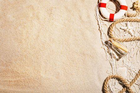 Photo pour Background with sandy beach, top view. Summer accessories concept - image libre de droit