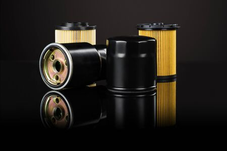 Photo pour Various car or automotive parts on black background with reflection and copy space around products - image libre de droit