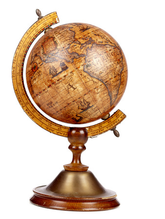 An old brown vintage globe on a small stand over a white background