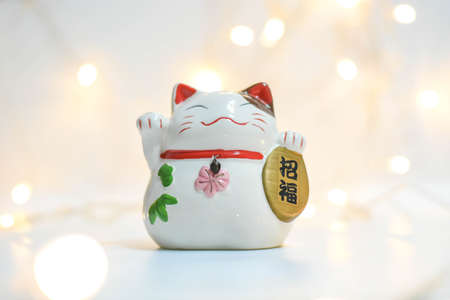 Photo for Smile maneki neko ceramic doll with Blur background - Royalty Free Image