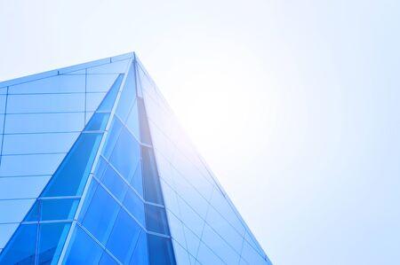 Foto de Side view of Skyscraper Business Office with blue sky, Corporate building in city with light flair. - Imagen libre de derechos
