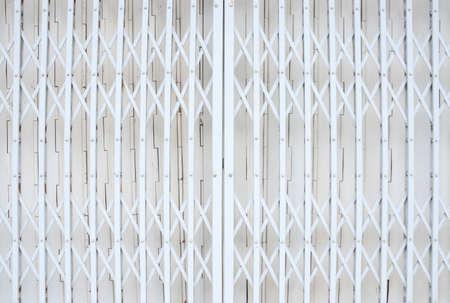 Photo pour Closed slide folding steel front door white tone vintage style of townhome - image libre de droit