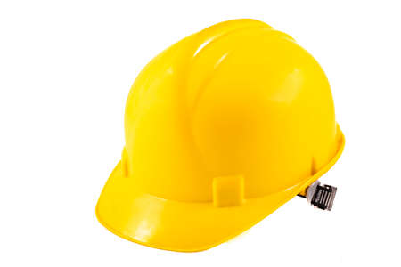 Photo pour Yellow hard hat for construction workers. Protective clothing and accessories for employees. Light background. - image libre de droit